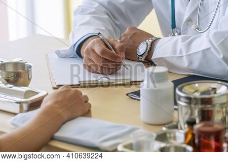 Professional General Practitioner Doctor Man Wear Uniform With Stethoscope While Appointment Talking