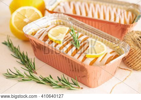 Lemon Butter Cake Or Pound Cake Top With Lemon Icing Glaze Decorated With Lemon Sliced And Rosemary
