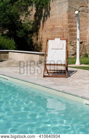 Swim Pool With Clear Blue Water And Two Sun Bed On Sunny Day In A Yard, Beautiful Vacation For Relax