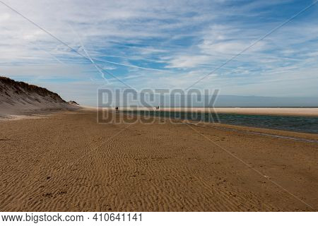Walking On The North Sea Beach On A Sunny Winter Day Near The Slufter Valley On The Wadden Island Of