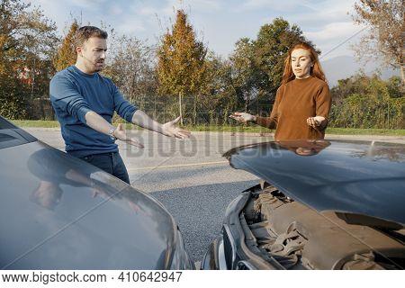 Man And Woman Arguing After Car Crash