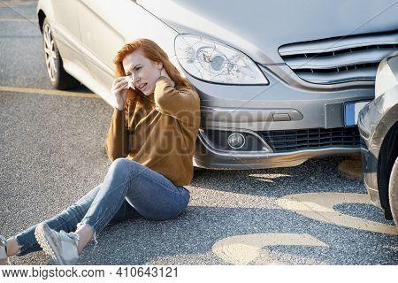 Woman Feeling Pain After Dangerous Car Crash