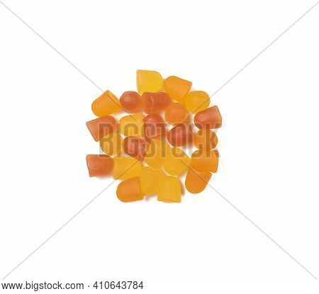 Close-up Texture Of Orange And Yellow Multivitamin Gummies On White Background.  Healthy Lifestyle C