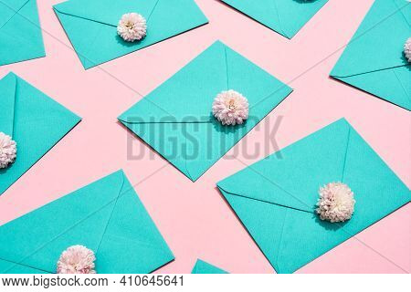 Envelopes Lying With Flowers In Honor Of March 8. Envelopes As A Gift Lying On A Pink Background. Be