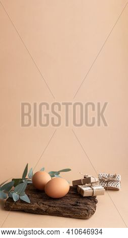 Vertical Banner. Easter Eggs With Eucalyptus Branch And Sustainable Gift Boxes