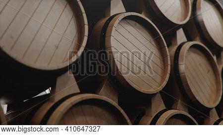 Barrels Of Wine, Whiskey, Bourbon Liqueur Or Cognac In The Basement. Aging Of Alcohol In Oak Barrels