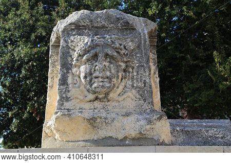 Zadar, Croatia - September 14, 2016: This Is A Carved Face Of One Of The Roman Gods, Left On The Sto
