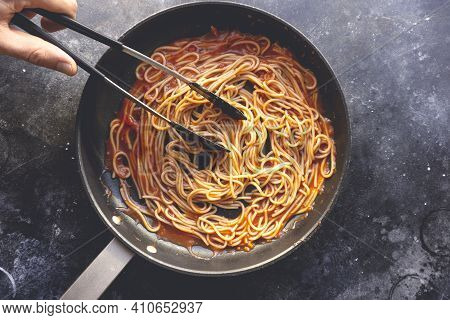 Tomato Pasta Is Cooked In A Frying Pan On The Kitchen Background. Italian Pasta Background. Italian