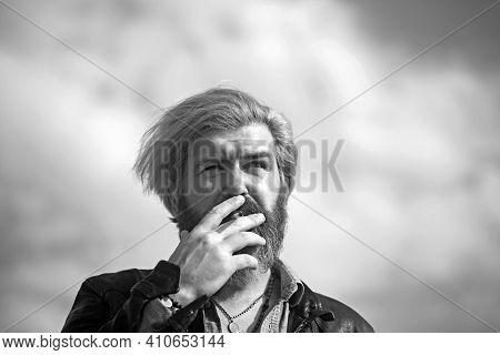 Fashion Man Smoking On Sky Background. Fashion Smoker With Cigarette On Fresh Air.
