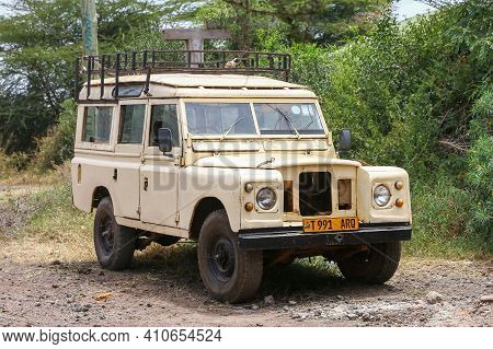 Arusha, Tanzania - February 5, 2021: Old Offroad Vehicle Land Rover Series Iii In The Town Street.