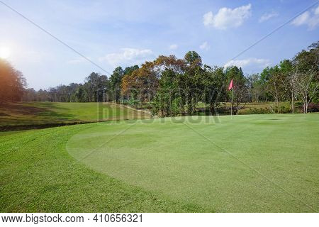 Background Of Evening Golf Course Has Sunlight Shining Down At Golf Course In Thailand. Nice Scenery