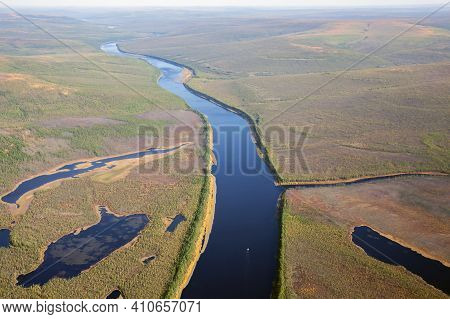 Autumn Colors Of The Siberian Taiga With Rivers And Lakes From A Helicopter. Top View Of The Expanse
