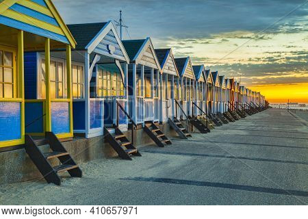 Beach Huts At Southwold In Suffolk, England At Sunrise.