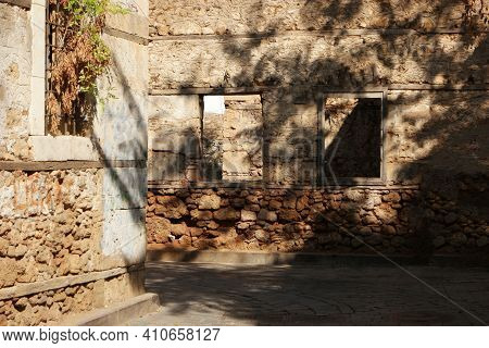 View To Ruined Natural Stone Building. Alleyway At Historic Turkish Town. Ancient Architecture Backg