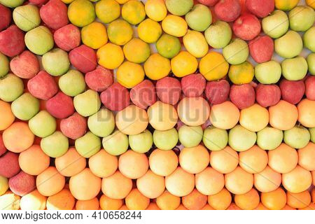 Assortment Of Fresh And Natural Fruits Sorted By Color. Assorted Fruits Texture. Food Background.