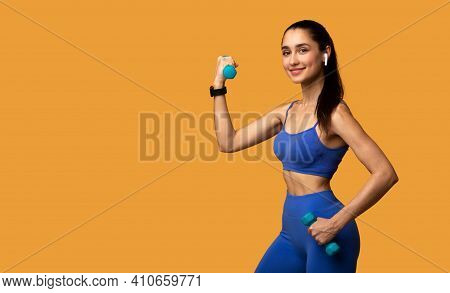 Gym And Fitness Club Advertisement. Portrait Of Cheerful Young Strong Woman In Wireless Headphones E