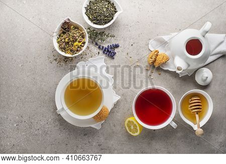 Herbal Tea, Green Tea, Fruit Tea Cups With Honey And Cookies On Grey Background