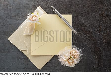 Beautiful Wedding Invitation Card With Floral And  Letter Envelope. Writing Letter On Blank Paper Wi