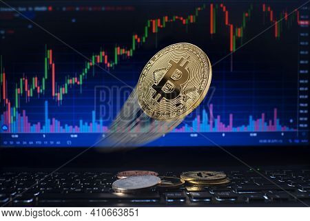 Golden Bitcoin Flying Whit Computer Trading Chart Background. Bitcoin And Altcoin The Most Important
