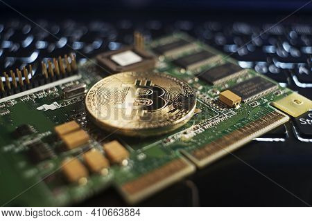 Golden Coins With Bitcoin Symbol On A Mainboard. Bitcoin Finance Concept