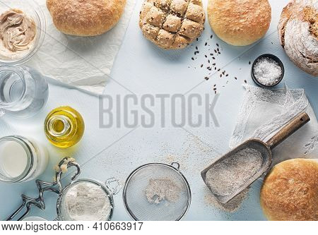 Ingredients For Making And Baking Homemade Bread On Blue Table Background