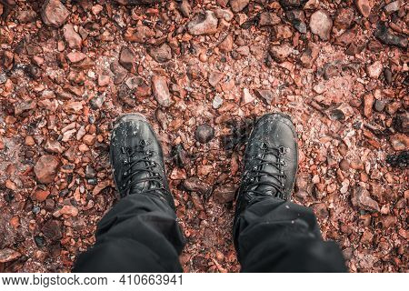 Muddy Boots. Point Of View Of Muddy Hiking Boots In A Muddy Puddle. Winter Adventure Hiking Around P