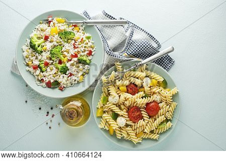 Fresh Pasta Salad And Rice Salad With Mixed Vegetables In Plates On Blue Background. Healthy Pasta A