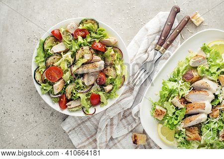 Healthy Chicken Meals With Grilled Chicken, Vegetables, Croutons And Creamy Sauce On Grey Background