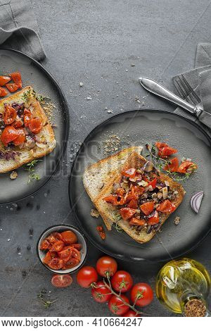 Appetizer Served With Grilled Bread, Tomato, Onion And Herbs. Bruschetta With Roasted Tomatoes. Cont