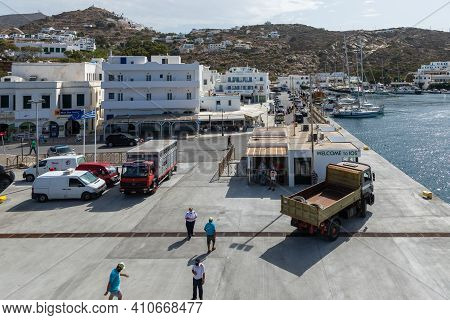 Port On The Island Of Ios, Greece - 26 September 2020: View Of The Harbor Of Ios Island. People Wait