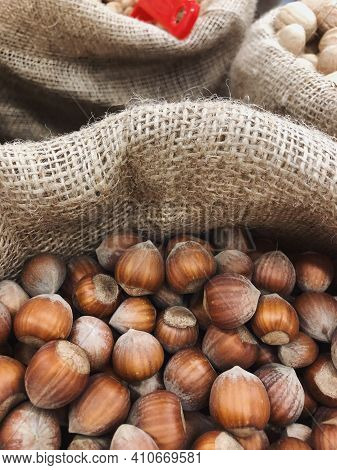 Hazelnuts In Shell In Pouch On The Rustic Background. Selective Focus. Hazelnuts In A Bag. Lots Of H
