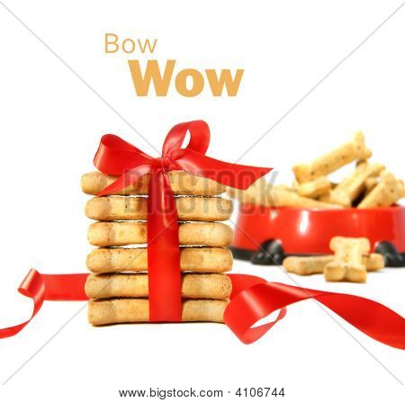 Dog Biscuits Wrapped With Red Bow On White