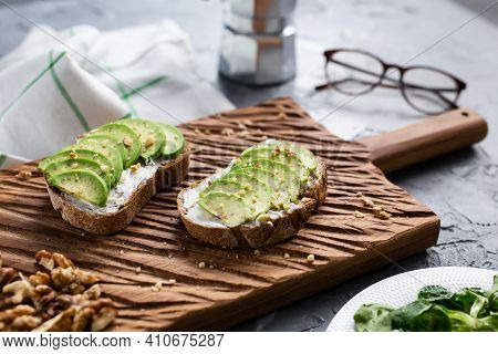 Sliced Avocado On Toast Bread With Nuts