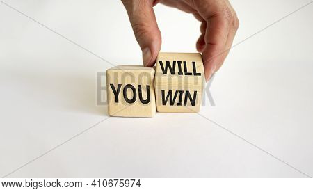 You Will Win Symbol. Businessman Turns Cubes And Changes Words You Will To You Win. Beautiful White