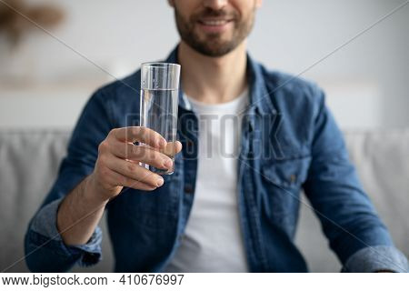 Cropped Of Middle-aged Man Holding Glass Of Spring Water At Home, Unrecognizable Healthy Bearded Man