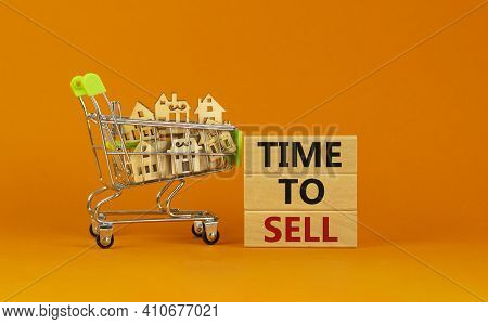 Time To Sell Real Estate Symbol. Wooden Blocks, Words 'time To Sell' On Beautiful Orange Background.