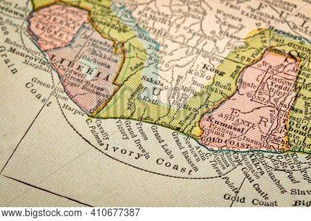 Ivory Coast of Africa on vintage 1920s map, selective focus, geography concept