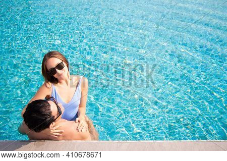 Sexy Happy Caucasion White Couple Embracing In Swimming Pool Vacation