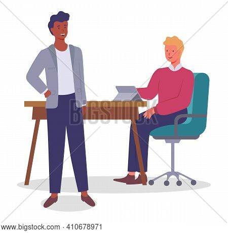 Two Young Office Workers Communicate, Laugh. Guy With Red Sweater Sitting On Green Chair At Table Wi