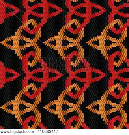 Geometrical Ornate Seamless Knitted Vector Pattern As A Fabric Texture In Red, Orange And Black Colo