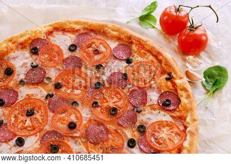Traditional Pizza With Salami. Tomatoes. Garlic Italian