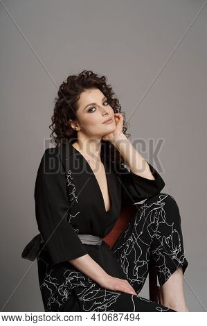 Portrait Of Cute Woman With Modern Hairdo In Stylish Clothes Holding Two Hands In Pockets Isolated O