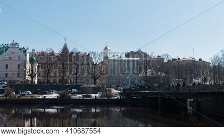 Beautiful Houses And A Bridge Over The River. Vyborg City, Russia. The Oldest City That Used To Belo