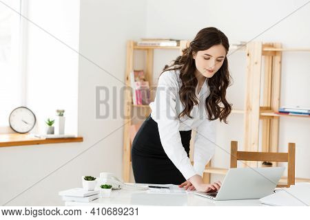 Work From Home Concept - Beautiful Young Woman In Her Home Working On Laptop. Working At Home. Quara