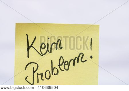 Kein Problem (no Problem)  Handwriting Text Close Up Isolated On Yellow Paper With Copy Space.
