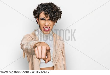 Handsome man wearing make up and woman clothes pointing displeased and frustrated to the camera, angry and furious with you