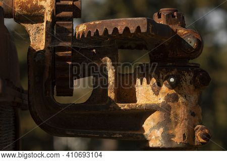 Rusty Metal Parts Belonging To An Old Abandoned And Disused Tractor, Formerly Used In The Agronomic