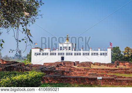 Lumbini, Nepal - February 23 2021: Holy Maya Devi Temple In Lumbini, Nepal. Sacred Pilgrimage Site F