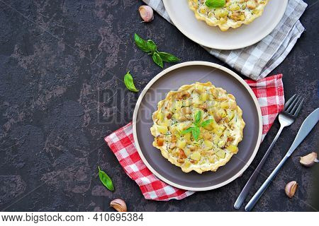 Portion Mini Tart With Chicken, Zucchini And Fried Onions On Shortcrust Pastry With Sour Cream And E