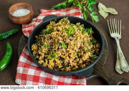 Dirty Rice, Cajun Cuisine Dish, Rice With Liver, Minced Pork, Aubergine, Green Pepper And Spices In
